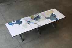 Conference table made out of recycled city maps for Boston's Chief of Policy Joyce Linehan