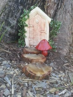 This little door sits at the base of our peppermint gum tree.  The door is made from concrete and was purchased at a local nursery, the ivy is actually plastic…