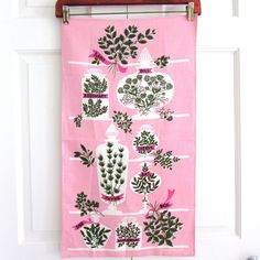 Note to self: idea for hanging quilt - piece of wood with metal clips like hanger??(Vintage Towel Herb Jars Ivan Bartlett Designer at NeatoKeen)