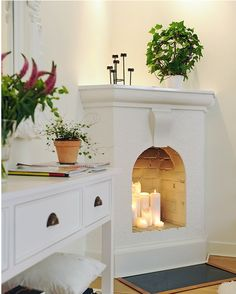 candle-lit fireplace for the mantle...yea i like those candles in there ive seen it done better but very pretty with all white