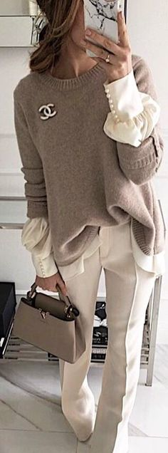 #spring #outfits  woman in gray Chanel sweater and white dress pants holding gray leather handbag. Pic by @woman__streetstyles