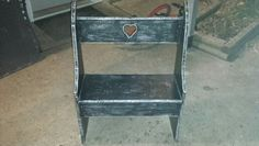Took black bench from garage sale n distressed edges with sandpaper to make it look country!
