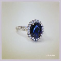 Pave Accented Oval Blue Sapphire Halo - click to enlarge