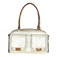 Felix Chien - Quilted Marlee Bag Pearlized ivory and faux-snake trim  (http://www.felixchien.com/quilted-marlee-bag-ivory/)