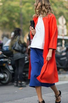 Try a red coat for an instant pop of color this winter. Click for 11 street style pictures that'll show you how to wear the color this winter.