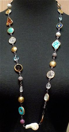 """A lovely innovation from Designer ARA 24K Gold,  fire opal, Sleeping Beauty Turquoise,  coins in relief, 24K gold beads, """"evil eye"""" glass, rose quartz, white topaz, sapphire beads, pearls, 34""""L  (NOTE, lobster closure allows this necklace to be worn double wrapped)"""