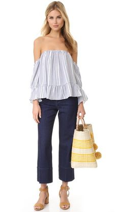 Thin stripes detail this MISA off-shoulder crop top. Gathered elastic neckline. Long sleeves.