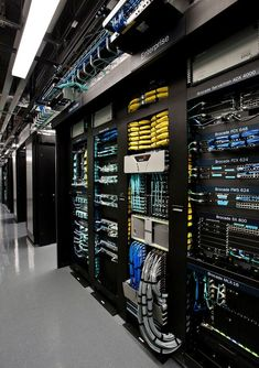 Server racks in the Brocade corporate data center in San Jose, USA. Cable management, switch, ethernet, fiber channel