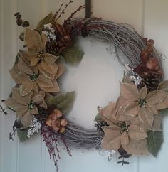Grapevine wreath with burlap poinsettias, pinecones and foliage. Christmas Holiday Winter Wreath