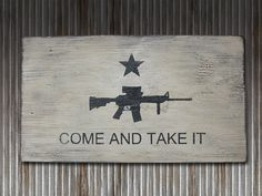 """""""Come and take it"""" is an American patriotic slogan most notably used in 1778 at Fort Morris in Georgia during the American Revolution, and later in 1835 during the Texas Revolution.     The phrase is similar to Molon labe, which is a classical expression of defiance reportedly spoken by King Leonidas I in response to the Persian army's demand that the Spartans surrender their weapons at the Battle of Thermopylae.    Come and Take It Flag Wall Art with   Modern AR by RusticPost  $25.00"""