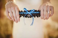 Perfect for surprising your police officer husband on your wedding day ~ a Thin Blue Line bridal garter in royal blue and black satin, complete with a silver handcuff charm!