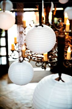 variety of brown ribbons gave the paper lanterns an antique look.