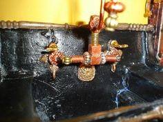 Miniature Endeavors: [Overheard in The Forum]   Kitchen Faucet Tales  Sink has a faucet with a Steam Punk look and a spout able to rotate.