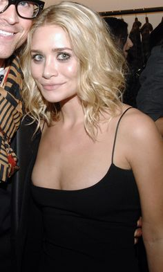 Ashley looking beautiful at a The Row event with a curly long bob, simple makeup and a black...