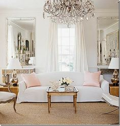 I love pairings of mirror images this is a visual delight in the use of two large scale Venetian mirrors in a french inspired sitting room tres chic...