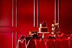 Casings finished in steeped red make for walls nearly as delectable as the dessert table. | Oh So Red 1009-1, @Valspar