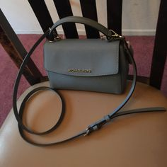 Michael Kors small Ava AUthentic only used once. Light blue, super cute color, goes well with everything. Michael Kors Bags Crossbody Bags