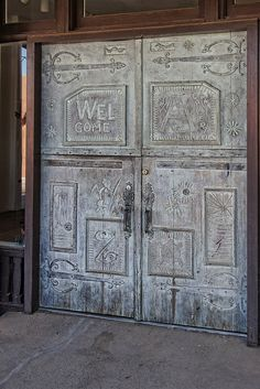 Taos, New Mexico. WELCOME is written into the door. The detail is amazing.