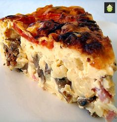 The Naked Quiche!  Mac n cheese, baby meatballs, bacon, mushrooms all set in a delicious cheesy egg custard. This is best eaten warm when its all cheesy soft and scrumptious! It's real fun to make too!