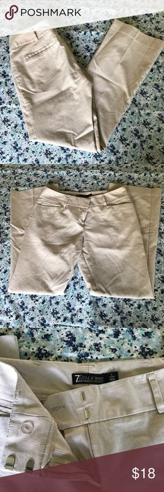 7th Avenue Tan and White Dress Pants Brand:7th Avenue New York & Co. Color / Pattern:Tan and white stripes Size:4P Condition:Only worn once. No flaws. Waist:31 in. Rise:9 in. Inseam:29 in. Hem:18 in.   NO TRADES. All reasonable offers are considered. New York & Company Pants Trousers