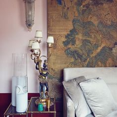 The architect and designer @FabrizioCasiraghi brought together African masks, French bamboo chairs, Chinese screens and more — all in one eclectic Venetian apartment that Casiraghi's agent, Julien Desselle, calls home in the city. Here, the living room, where 1930s Barovier&Toso crystal sconces bookend a vintage Azucena Pinacoteca sofa and an 18th-century Chinese screen. Photo by Danilo Scarpati.
