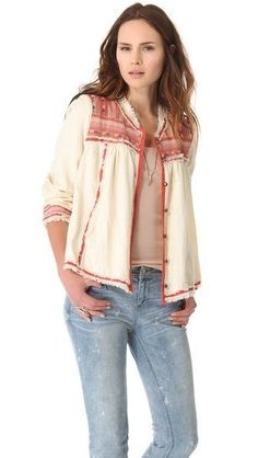 A bohemian-inspired Free People jacket detailed with colorful embroidery and frayed edges. Soft pleats and a rounded hem add sweet texture, ...