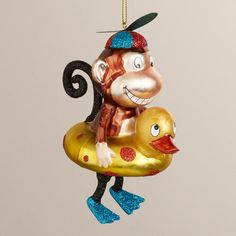 I don't know why... but I have never Needed to own a Christmas ornament more... ;o)  at WorldMarket.com: Glass Swimming Monkey Ornament