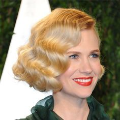 Pin for Later: Endless Gorgeous Celebrity Wedding Hair Ideas Wedding Hairstyles: All Down Wouldn't the fetching finger waves January Jones wore at the 2012 Vanity Fair Oscars party look gorgeous peeking out from beneath a demi-veil?