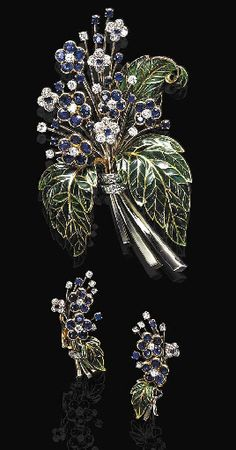 AN ATTRACTIVE SET OF SAPPHIRE, DIAMOND AND PLIQUE-A-JOUR ENAMEL JEWELRY, BY BOUCHERON  Comprising a brooch, designed as a bouquet extending a spray of circular-cut sapphire and diamond flowers, with green plique-à-jour enamel leaves, gathered together by a circular-cut diamond ribbon; and a pair of ear clips en suite, mounted in 18K gold, with French assay marks and a maker's mark, in original blue leather pouch  Ear clips signed Boucheron No. 556