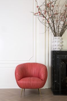 KELLY WEARSTLER   RED LEATHER SOUFFLE CHAIR. Ruched leather detail. Full-finish, vegetable dyed lambskin. This exquisitely detailed and luxurious chair sits on tapered legs of solid cast bronze.