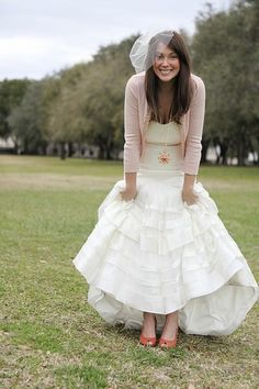 This girl wore a cardigan with her wedding dress. Perfection.