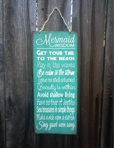 Mermaid Wisdom Measures 8 wide x 18 tall.    Hand painted with a distressed beach look. Jute Twine hanger on top. Great for indoor or outdoor use