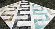 Hi everyone! I'm Tammie Schaffer of craftytammie, and I am happy to be back here at the Bake Shop with my newest recipe, zippy. This quilt top is made entirely of charm squares and half square tria...
