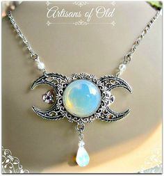 Opalite triple goddess pendant, which measures about 2.5L by 1.25H has antique sterling plated filigree crescents with silvertone pendant tray.