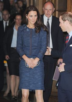 Kate Middleton looked refined in this blue tweed skirt suit with raw edging at the Royal British Legion.  Brand: Rebecca Taylor