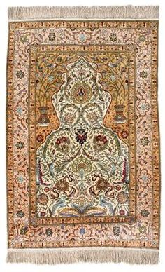 Hereke silk,Northwest Anatolia (Turkey), c. 190 x 126 cm, first half of the 20th century, large silk prayer rug with vase and animal motifs, good age with c. 600.000 kts/sqm, in excellent colour condition and overall state of preservation, heavy grip. (MA)