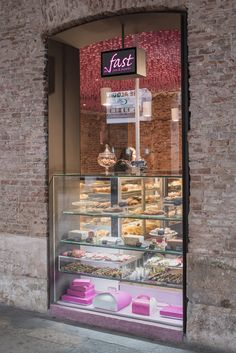 Pan y Pasteles Madrid by ideo arquitectura Architect and designer Virginia del Barco, founder of Spanish practice ideo arquitectura, suspended wooden sticks within this bakery in Madrid.