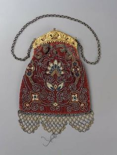 Bag clasp and bag, made in France 18C. @ MFA Boston.  Crimson velvet embroidered with chenille, steel and gilt beads.
