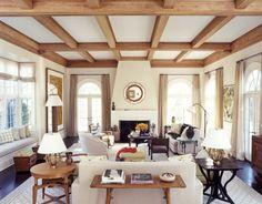 Cottage Living Room with Carpet, metal fireplace, Box ceiling, Window seat, Hardwood floors