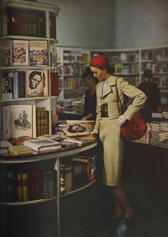 Book shopping | Photograph by George Hoyningen-Huene for Harper's Bazaar, March 1944 #books #vintage #1940s