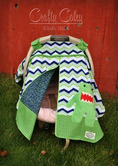 Chevron Carseat canopy with Domo Kun monster applique. Adorable boy carseat canopy. . & Glam Skulls padded camera strap cover with lens cap pocket. $25 ...