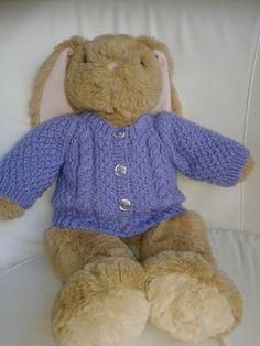 Teddy aran cardigan from my pattern on Ravelry.  This is the larger size and fits my grandaughter's 43cm build a bear bunny