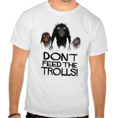 Don't Feed The Trolls! Funny cartoon trolls by Paul Stickland on a Do Not Feed The Trolls custom t shirt. They all say you should not feed the trolls when you are browsing some forum or other on the internet, not even when this web based life-form looks so funny and friendly! From an original hand drawn illustration by Paul Stickland for StrangeStore, home of the best geek gifts and funny cool t shirts! Click here to see my StrangeStore Funny T Shirt Collection!