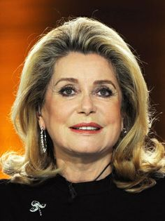 Catherine Deneuve is supposedly 68 years old. She looks great with her longer locks.