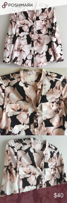 "Calvin Klein Floral Dressy Button Down Shirt A lovely floral pattern of light nude, blush pink, black and cream that pairs well with denim and slacks. V-neck button front closure, collarless, cuff sleeves and flap chest pockets. Length 26"" Soft silky abstract dress work shirt blouse Purchased At Nordstrom Keywords: Long Sleeves Buttons Up Pattern Print Solid Flowers Striped Checkered Plaid Paisley Colorblock Pastel Blush Cuffable Lilac Marled Multi Colored Cuffed Calvin Klein Tops Button…"