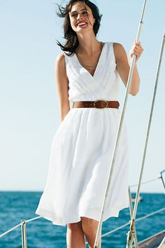 """Summertime"" the most beautiful word in the English language, and nothing says ""summer"" better then a classic white linen dress."