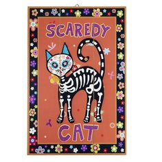 Can't pick a favorite Halloween tradition? You're in luck, because our wooden wall decor combines several of them. The orange planks showcase a black cat skeleton with a colorful <i>calavera</i> skull, which makes it a great addition to any All Hallow's Eve or Day of the Dead celebration.