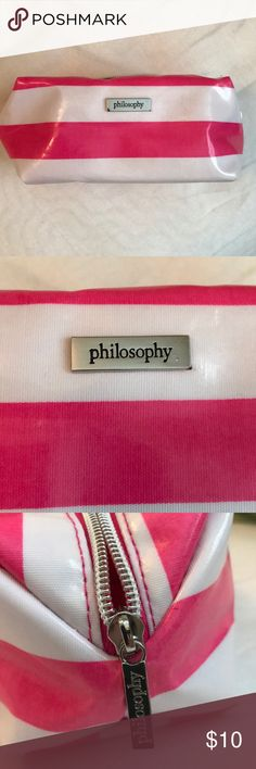 Philosophy Makeup Bag! Pink and white philosophy Makeup Bag! Brand new, never used! No rips or tears! Zipper runs smooth! Inside very clean! No trades, no low balls! Happy Poshing! Philosophy Bags Cosmetic Bags & Cases