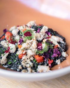 """"""" Essentially a squid ink risotto, it's filled with salmon roe, olive tapenade, shreds of poached crab meat and bonito flakes. Tuna Loin, Salmon Roe, Black Rice, Tapenade, Crab Meat, Flakes, Acai Bowl, Risotto, Drinks"""