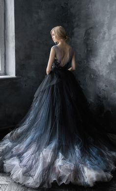 Uniquely glamorous black, blue and silver grey tulle ballgown wedding dress; Featured Dress: CarouselFashion